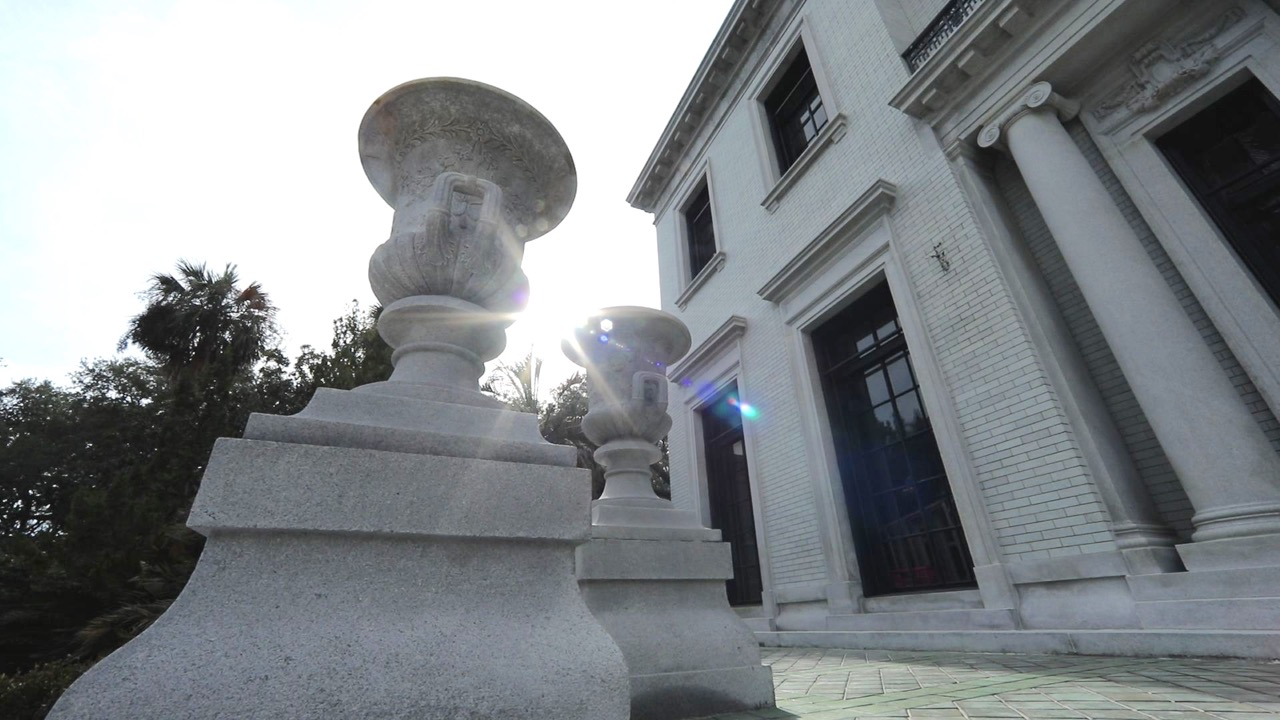 Granite urns flank the entrance to the Mansion.